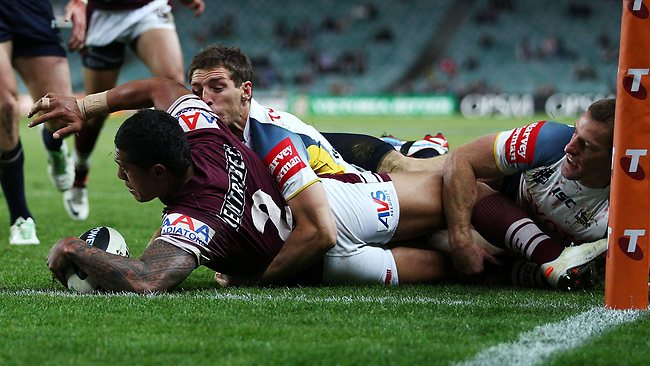 LINE BALL: Sea Eagles winger Jorge Taufua puts the ball down short of the line before his try. Picture: Mark Nolan