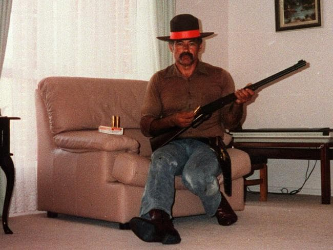 Backpacker killer Ivan Milat, whose murderous rampage partly inspired the movie Wolf Creek poses in his western Sydney living room.