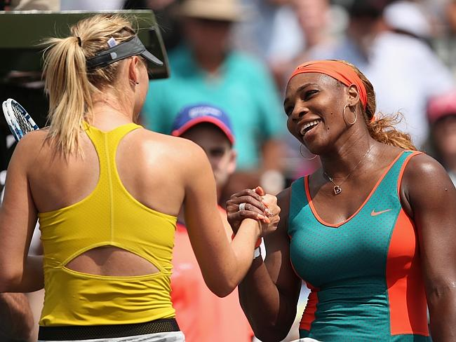 Serena Williams of the United States shakes hands at the net after her straight sets vict