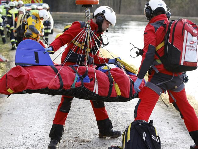 Rapid response ... rescue teams transport an injured person at the site of a train accident near Bad Aibling, Germany. Picture: Uwe Lein/dpa via AP