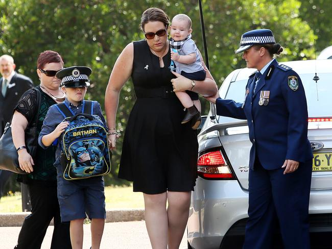 Margaret Richardson with sons Aiden, 5 months and Patrick 7 at the funeral. Picture: Troy Snook