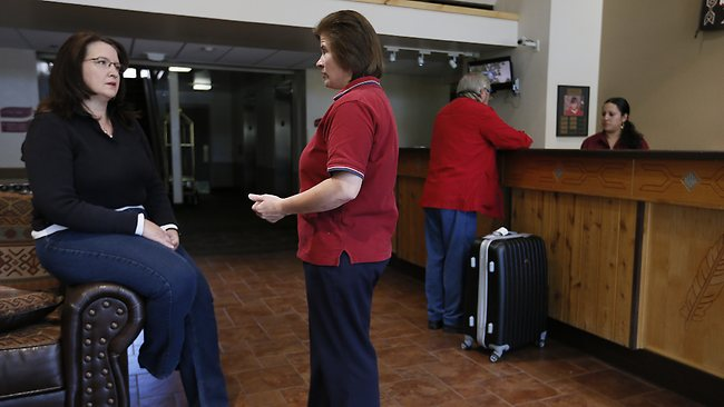 A concerned Julie Aldaz, left, general manager of the Red Feather Lodge, who has already had to layoff three employees, talks with Jane Gibson, housekeeping manager, about the drop in tourism due to the shuttering of the Grand Canyon. Picture: AP