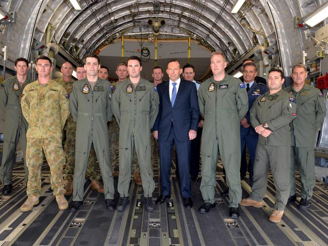 Praised efforts in extremely trying circumstances ... Prime Minister Tony Abbott Image meets crewmen of the Royal Australian Air Force C-17 aircraft. Picture: Ben Stevens
