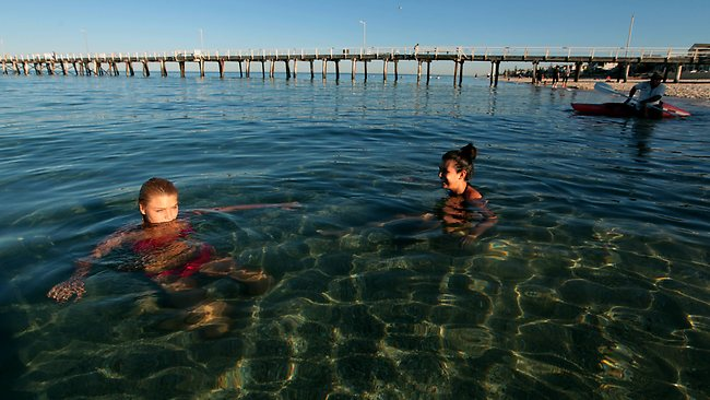 Emma Cirelli (16) and Carla Borrillo (16) enjoy an early moring cool down at Henley Beach, Adelaide. Picture: Kelly Barnes