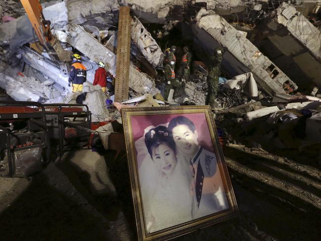 A recovered wedding portrait is propped up at the search and rescue staging area of a collapsed building complex in Tainan.