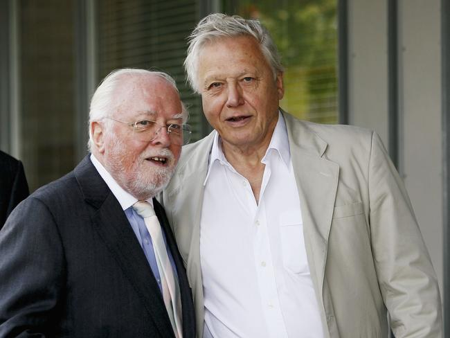 Richard Attenborough and Sir David Attenborough pose outside the 'Richard Attenbororugh' Building at the University of Leicester.