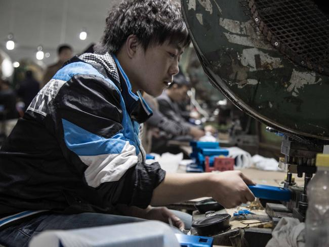 A man also sits on the assembly line of MP3 players. Picture: Kate Davies/Unknown Fields.