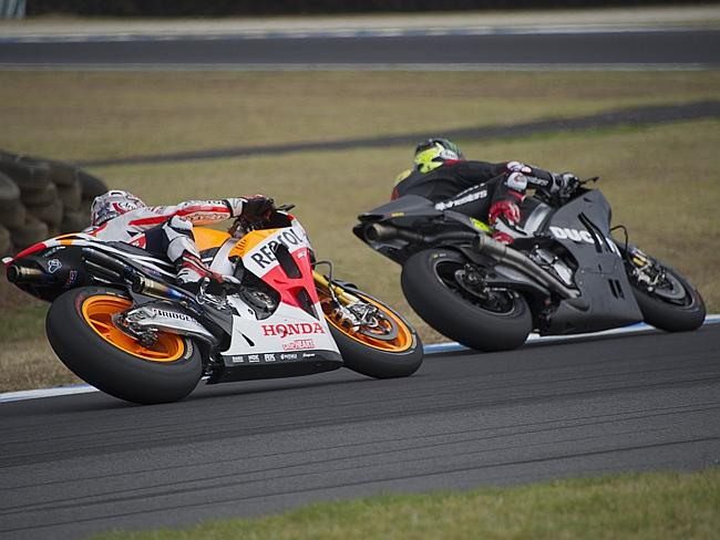 Dani Pedrosa of Spain and Repsol Honda Team follows Cal Crutchlow of Great Britain and the Ducati team during MotoGP testing in Phillip Island.