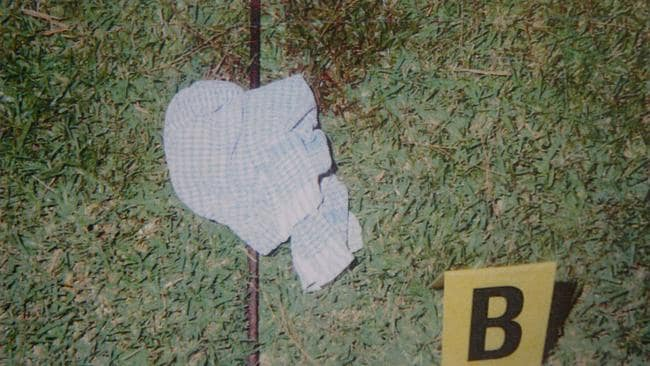 Police crime scene photographs of a pole in the back yard where Liam Knight was speared.