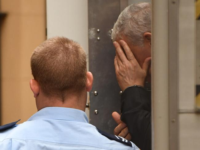Haydar Haydar covers his face as he made his way into court for sentencing today. Picture: AAP Image/Dean Lewins