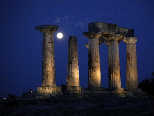 The super moon rises in the sky in front of the Apollo's temple at ancient Corinth about 80 kilometres southwest of Athens. AP Photo/Petros Giannakouris.