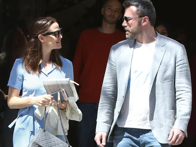 Jennifer Garner and Ben Affleck are all smiles despite filing for divorce as they leave church following an Easter service. Picture: Splash News and Pictures