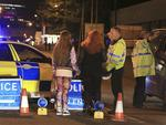 Police work at Manchester Arena after reports of an explosion at the venue during an Ariana Grande concert. Picture: AP