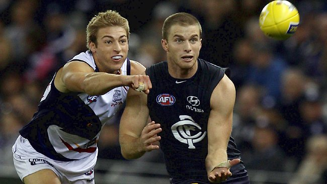 Lachie Henderson marks in front of Adelaide's Daniel Talia. Picture: Michael Michael