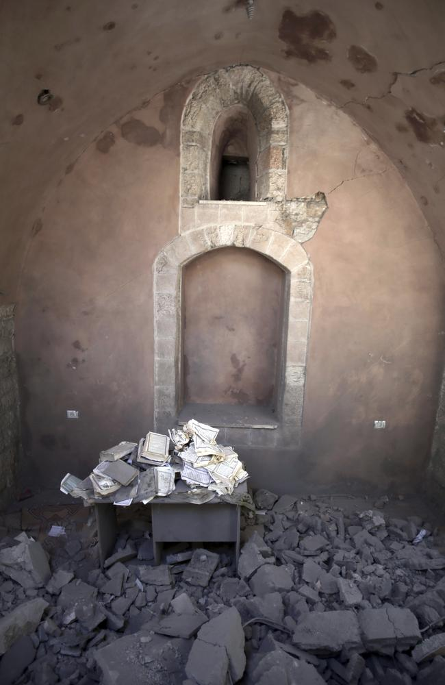 Pages of the Koran were salvaged from the rubble of the Al-Omary Mosque.