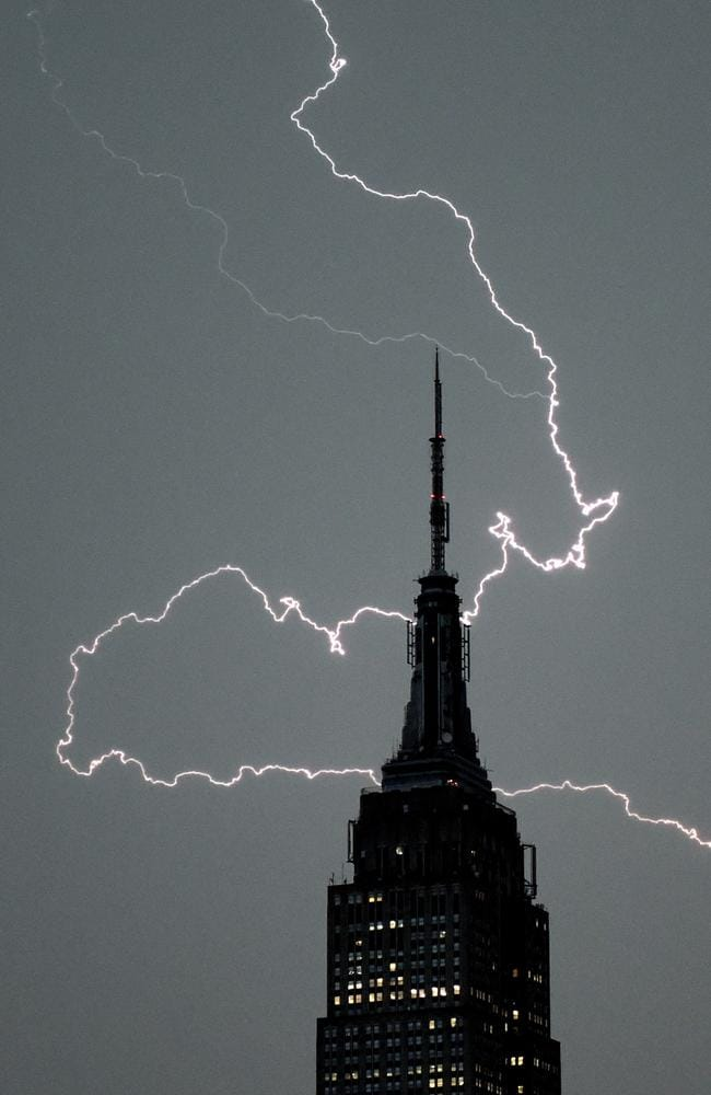 Bad weather ... lighting cracks over the Empire State Building in New York City on July 2. Picture: AFP