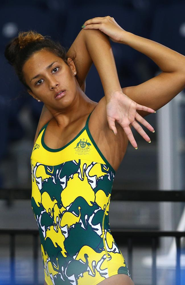 Kotuku Ngawati shows off Australia's training swimsuits.