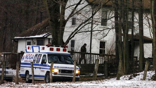 An ambulance parked outside the farmhouse where Kenzie Marie Houk was killed in Pennsylvania in 2009.