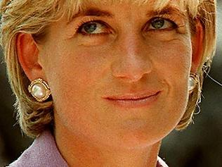 (FILES) This file photo taken on June 17, 1997 shows Britain's Diana, Princess of Wales (L), at a ceremony at Red Cross headquarters in Washington, to call for a global ban on anti-personnel landmines. Two decades on from the death of princess Diana, her sons Princes William and Harry are working to keep her legacy alive with unusually emotional tributes after years of official silence. William was 15 and Harry 12 when Diana died in a car crash in Paris on August 31, 1997. / AFP PHOTO / JAMAL A. WILSON