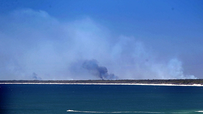 ISLAND ON FIRE: The smoke from Bribie Island fires viewed from Caloundra today. PIC: Glenn Barnes