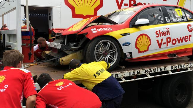 DJR Team Penske crew look at the damage to the No. 17 Falcon. Pic: Will Dale
