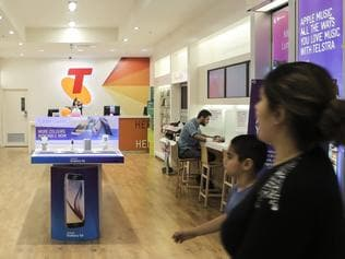 Pic of customers in Telstra shop