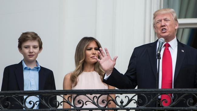 Barron Trump with his parents Melania and Donald Trump. Picture: Brendan Smialowski