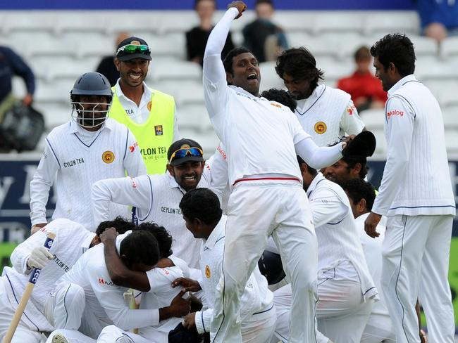 Sri Lanka's captain Angelo Mathews, centre, leads celebrations as Sri Lanka beat England.