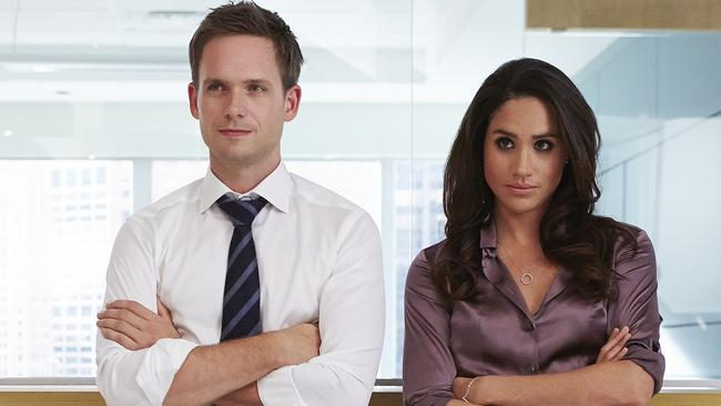 Meghan on the set of Suits with co-star Patrick J. Adams. Picture: Shane Mahood/USA Network