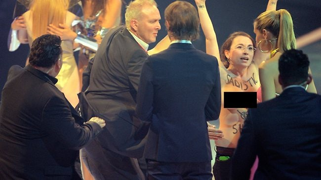 Two female protestors storm the stage during the broadcast of Germany's Next Top Model. Picture: Getty