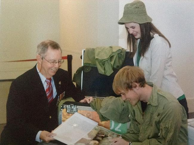 Republic of Vietnam Campaign Medal campaigner. Richard Barry shows Canberra High School students some of his Vietnam War souvenirs that are on permanent display at the Australian War Memorial.