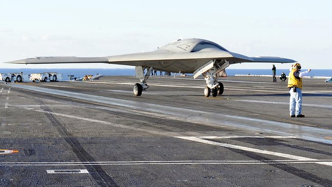 The X-47B Unmanned Combat Air System (UCAS) demonstrator taxies on the flight deck of the aircraft carrier USS Harry S. Truman. PIcture: U.S. Navy