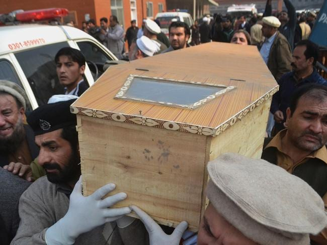 Heartbreaking ... The bodies of those killed are already being retrieved from hospitals. AP/Mohammad Sajjad