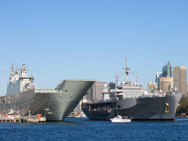 Big boys in town ... The USS Blue Ridge moves into position behind Australia's newest and largest ship, HMAS Canberra, at Garden Island Naval Base in Sydney, last week. Source: Defence.