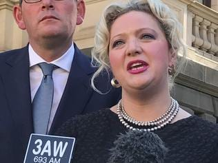 Victorian Health Minister Jill Hennessy (with Premier Daniel Andrews behind) speaks to the media ahead of the Victorian Parliament debating an assisted-dying bill on Tuesday, October 17, 2017. The bill would legalise an assisted-dying scheme for the terminally ill. (AAP Image/Kaitlyn Offer) NO ARCHIVNG