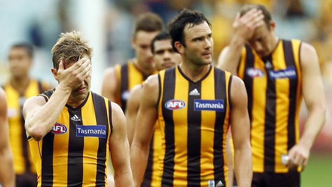 Sam Mitchell leads the hawks of the MCG after their 7 point loss to Geelong at the MCG. April 1, 2013. Picture: Klein Michael