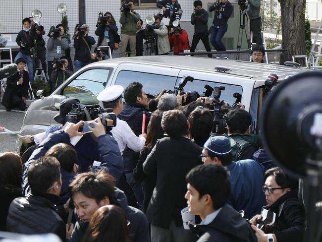 Photographers surround a police van transporting suspect Takahiro Shiraishi from a police station to the prosecutor's office in Tokyo on November 1, 2017. Picture: AFP / JIJI PRESS / STR / Japan OUT