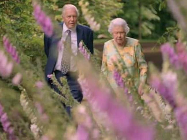 The Queen and Sir David Attenborough are filmed walking through Buckingham Palace's immaculate gardens. Picture: ITV