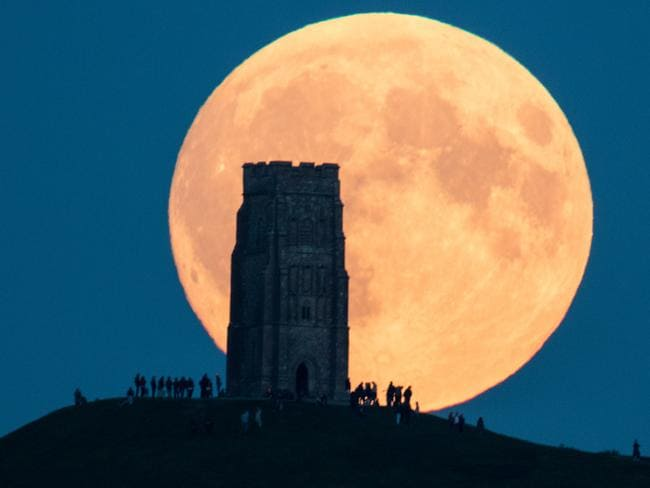 The supermoon rises behind Glastonbury Tor in Somerset, England. Picture: Matt Cardy/Getty Images