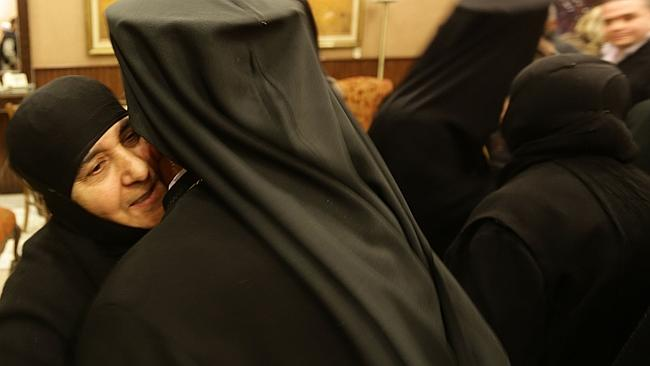 Freedom ... Blajaa Sayyaf (L), head of the nun monastery Maloula meets with church official upon her arrival at Jdeidet Yabus, on the Syrian side of the border with Lebanon.