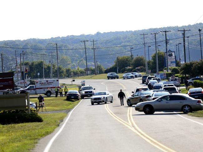 Scene of crime ... Authorities block the highway at Bridgewater Plaza where the shooting occurred. Picture: Stephanie Klein-Davis/The Roanoke Times via AP