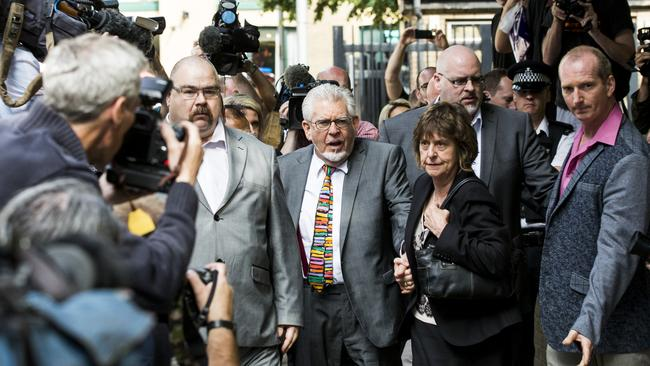 Holding hands ... Rolf Harris with his niece Jenny at Southwark Crown Court. Picture: Tristan Fewings