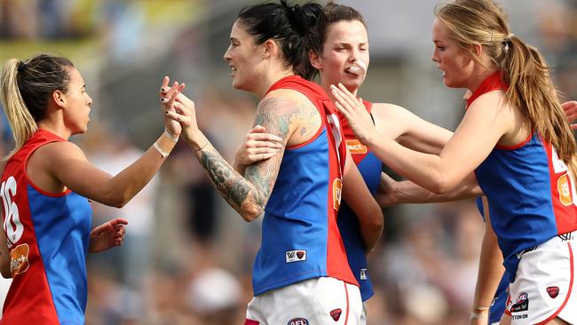 Tegan Cunningham celebrates after kicking a goal for the Demons. Picture: Getty Images