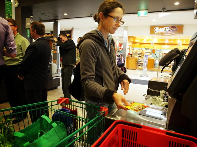 Who needs check-out chicks? … Shopper Gina Chapman-Davies tries out the self-service check-out machines at Woolworths supermarket in Northbridge, Sydney.