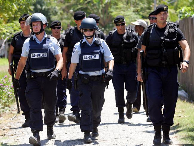 On the ground ... AFP officers with the Portuguese riot police in East Timor in 1999. Picture: Lindsay Moller