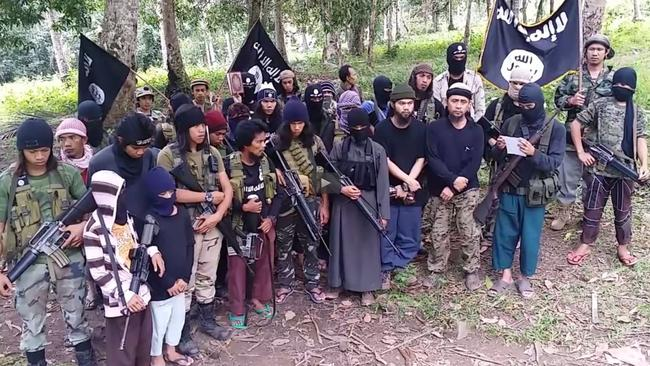Mindanao militants brandish the Islamic State flag.