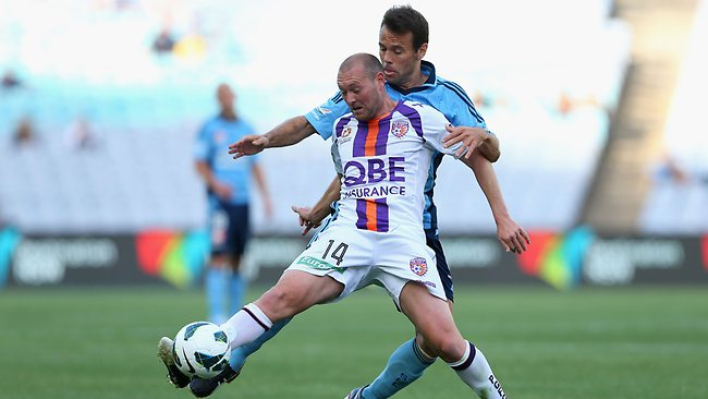 Steven McGarry of Glory is tackled by Paul Reid of Sydney FC during the round four A-League match between Sydney FC and the Perth Glory at ANZ Stadium. Picture: