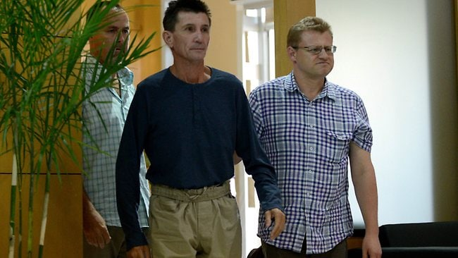 Australian hostage Warren Rodwell (C) who was recently released talks arrives at the Manila International Airport in Manila on March 25, 2013. Australian Warren Rodwell said on March 25 he was overwhelmed, happy and thankful at finally being free after 15 months as a hostage of Islamic militants in the southern Philippines. AFP PHOTO/NOEL CELIS