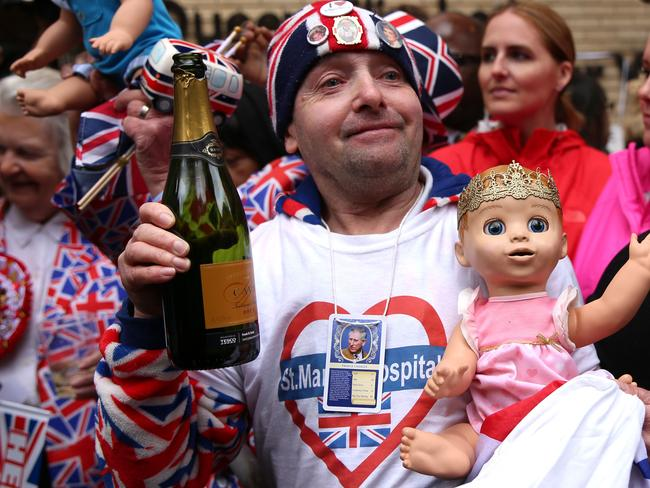 Fans toast the royal baby outside the Lindo wing. Picture: AFP PHOTO / Isabel INFANTES