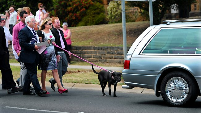 Sarah Cafferkey's mother Noelle Dickson and her beloved dog Sprocket lead the procession of mourners. Picture: Jon Hargest